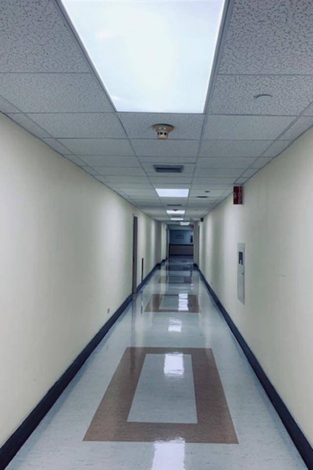 Hospital hallway after lighting changed to LED