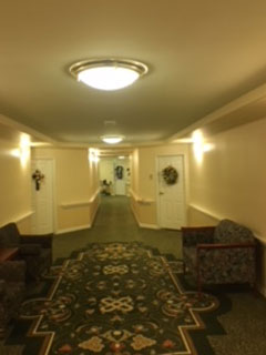 Hotel hallway before lighting changed to LED